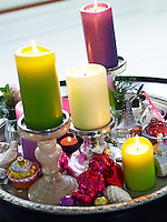 A tray in the living room contains a colourful array of Christmas candles and decorations