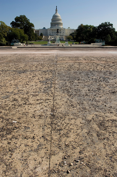 The drained reflecting pool on the west side of the Capitol looks like a dry lake bed on Monday, Oct. 15, 2007.