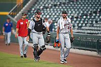 Scottsdale Scorpions catcher Joey Bart (27) and starting pitcher Tristan Beck (36), both of the San Francisco Giants organization, walk toward the dugout before an Arizona Fall League game against the Mesa Solar Sox on September 18, 2019 at Sloan Park in Mesa, Arizona. Scottsdale defeated Mesa 5-4. (Zachary Lucy/Four Seam Images)