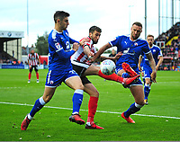 Lincoln City's Ollie Palmer vies for possession with Chesterfield's Jordan Flores and Ian Evatt<br /> <br /> Photographer Andrew Vaughan/CameraSport<br /> <br /> The EFL Sky Bet League Two - Lincoln City v Chesterfield - Saturday 7th October 2017 - Sincil Bank - Lincoln<br /> <br /> World Copyright &copy; 2017 CameraSport. All rights reserved. 43 Linden Ave. Countesthorpe. Leicester. England. LE8 5PG - Tel: +44 (0) 116 277 4147 - admin@camerasport.com - www.camerasport.com