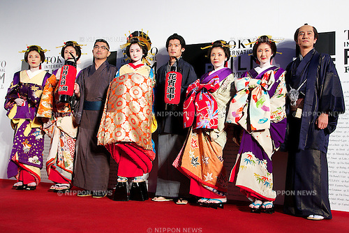 """Keisuke Toyoshima, Yumi Adachi, Hanako Takigawa, Oct 23, 2014 : Tokyo, Japan: Director of the movie """"A Courtesan with Flowered Skin"""" Keisuke Toyoshima and Actress Yumi Adachi pose for the cameras at the 27th Tokyo International Film Festival, Opening Event Red Carpet at Roppongi Hills Arena in Tokyo, Japan, October 23, 2014. This year the Prime Minister Shinzo Abe attends the opening ceremony. The Film Festival will run through until Friday 31. (Photo by Rodrigo Reyes Marin/AFLO)"""