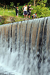 Boys fish near the edge of a water fall off of Tolland Ave. in Stafford, Tuesday evening, , July 19, 2011. Seen here, from left to right are,  Elijah Vang, 8, of Tolland,Bobby Lu, 15, of Stafford,  Kyle Haley, 15, of Stafford, Isaiah Vang, 14, of Tolland. (Jim Michaud/Journal Inquirer)