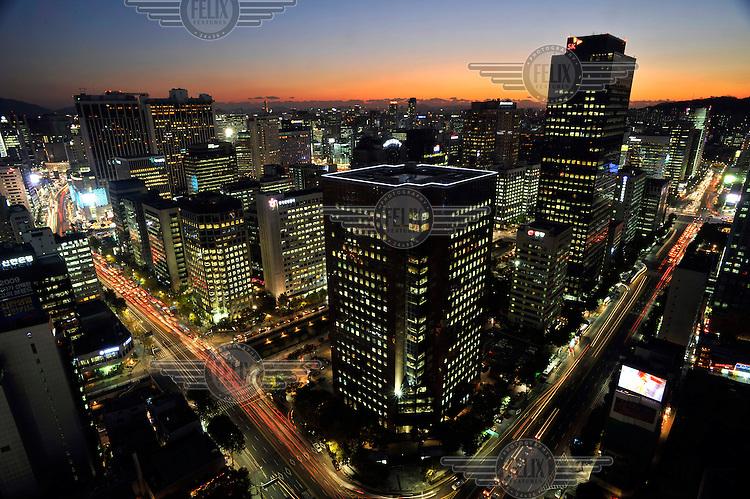 Nighttime street scene in central Seoul.