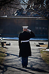 A Marine with Marine Barracks Washington holds his salute as the flag is raised above the Marine Corps War Memorial during a wreath laying ceremony Feb. 23, 2011. The ceremony marked the 66th anniversary of the flag raising on Mt. Suribachi during the battle of Iwo Jima. (Photo by USMC/AFLO)