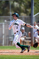 Dartmouth Big Green shortstop Nate Ostmo (5) hits a double during a game against the Villanova Wildcats on March 3, 2018 at North Charlotte Regional Park in Port Charlotte, Florida.  Dartmouth defeated Villanova 12-7.  (Mike Janes/Four Seam Images)