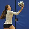 Plainview JFK No. 2 Joanna Savino, a left-handed hitter, serves during a Nassau County varsity girls' volleyball match against Massapequa at Plainview JFK High School on Monday, October 19, 2015. Massapequa won 25-16, 25-8, 25-13.<br /> <br /> James Escher