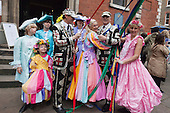 Covent Garden, London, UK. 11 May 2014. Costumed maypole dancers pose with Pearly Kings. The Covent Garden May Fayre and Puppet Festival takes place at St Paul's Church.
