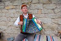 Estonia, Muhu Island. Muhu Jaanalind, guest house and farm. Traditional dancers and Meelis Mereaar, acccordion player.
