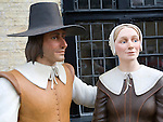 Figures of man and woman outside Oliver Cromwell house in Ely, Cambridgeshire, England