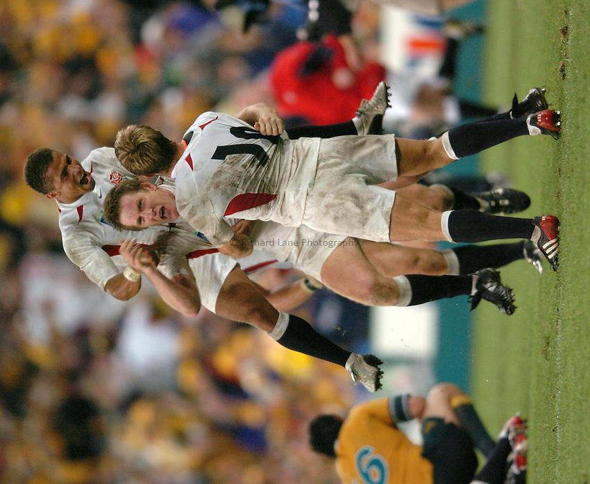 Photo: Richard Lane..Australia v England. Rugby World Cup Final, at the Telstra Stadium, Sydney. RWC 2003. 22/11/2003. .Jason Robinson and Will Greenwood celebrate victory with Jonny Wilkinson.