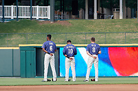 Frisco RoughRiders outfielders Brandon Davis (6), Eliezer Alvarez (10), and Preston Beck (8) during the national anthem before a Texas League game against the Springfield Cardinals on May 6, 2019 at Dr Pepper Ballpark in Frisco, Texas.  (Mike Augustin/Four Seam Images)