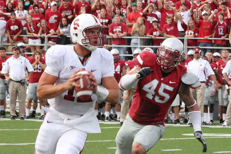 Andrew Luck, Stanford Cardinal quarterback, is pursued by Washington State linebacker, Andy Mattingly (#45), during Stanford's Pac-10 conference football game against Washington State at Martin Stadium in Pullman, Washington, on September 5, 2009.  The Cardinal prevailed over the Cougars, 39-13.
