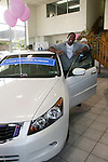 Guiding Light's actor Lawrence Saint-Victor poses by one of the cars at Moon Township Honda on October 1, 2009 in Pittsburgh, PA area as the actors visit Moon Township Honda after going to the various GO PINK Panera Bread locations. Proceeds from pink ribbon bagel sales will benefit the Young Women's Breast Cancer Awareness Foundation. (Photo by Sue Coflin/Max Photos)