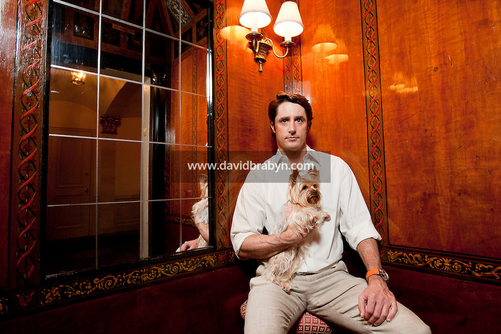 Cosmetics entrepreneur, television celebrity and animal advocate, Lorenzo Borghese poses for the photographer holding his girlfriend's Yorshire Terrier dog Coco in New York, USA, 26 May 2011.