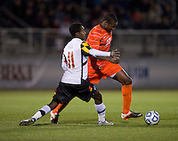Richard Robinson (27) of Clemson is defended by Mikias Eticha (11) of Maryland during the game at the Maryland SoccerPlex in Germantown, MD. Maryland defeated Clemson, 1-0, in overtime.  With the win the Terrapins advanced to the finals of the ACC men's soccer tournament.
