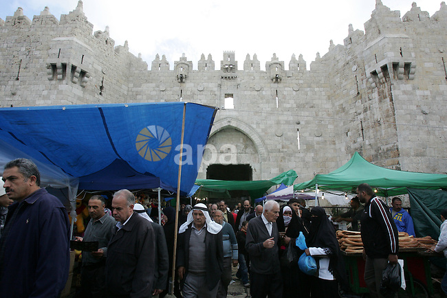 "Palestinians shop in front of the Damascus gate in Jerusalem's old city on Nov. 4,2011, ahead of the Muslim Eid al-Adha festival at the end of the week. Muslims across the world are preparing to celebrate the annual ""Festival of Sacrifice"", which marks the end of the Hajj pilgrimage to Mecca and in commemoration of Prophet Abraham's readiness to sacrifice his son to show obedience to God. Photo by Mahfouz Abu Turk"