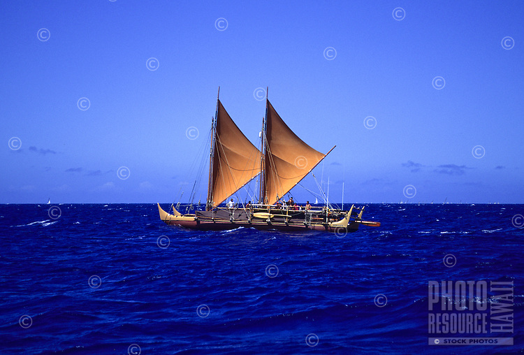 Historic Polynesian voyaging canoe, Hokule'a, sails offshore of Honolulu, Oahu, Hawaii