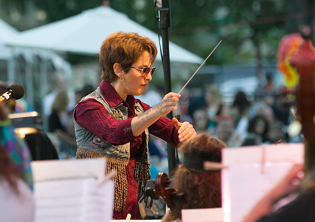 """Conductor Maestro Laura Jackson during the Pops on the River """"A night at Woodstock"""" concert at Wingfield Park in downtown Reno on Saturday, July 13, 2019."""