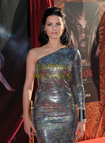 "JAIMIE ALEXANDER .The Marvel Studios Premiere of ""THOR"" held at The El Capitan Theatre in Hollywod, California, USA. .May 2nd, 2011.half length dress silver one shoulder sleeve metallic cuff bracelet .CAP/RKE/DVS.©DVS/RockinExposures/Capital Pictures."