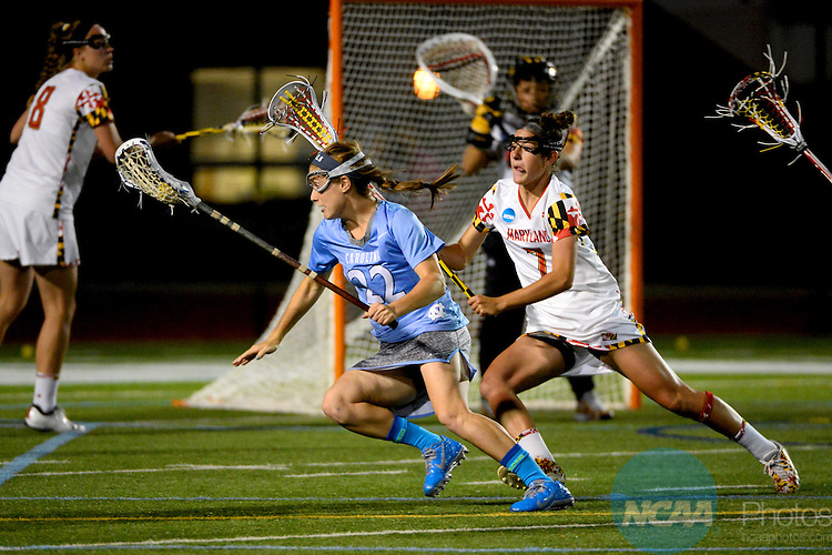 26 MAY 2013:  Emily Garrity (22) of the University of North Carolina drives towards the goal against Katie Schwarzmann (7) of the University of Maryland during the 2013 NCAA Women's Division I Lacrosse Championship held at Villanova Stadium on the campus of Villanova University in Villanova, PA. North Carolina defeated Maryland 13-12 in overtime to win the national title. Brett Wilhelm/NCAA Photos