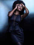 High fashion photo of a beautiful african american woman in stylish black shiny clothes