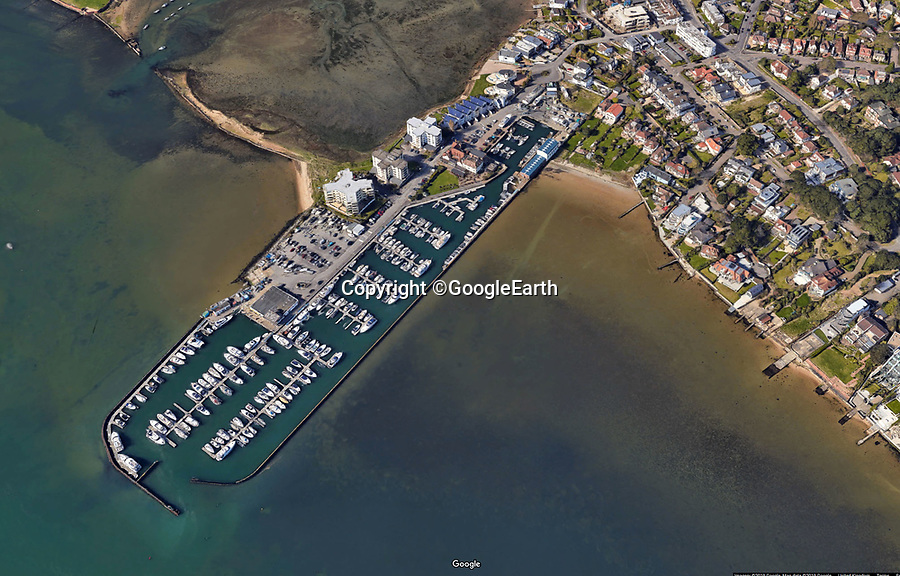 BNPS.co.uk (01202 558833)<br /> Pic:  GoogleEarth<br /> <br /> Exclusive Salterns Marina in Poole harbour.<br /> <br /> The ex-fiancee of a millionaire businessman attacked his new girlfriend after breaking down the door of the toilet cubical she was in at an exclusive marina, a court heard.<br /> <br /> Samantha Newby-Vincent and Max Walker were having drinks on the harbourside terrace to celebrate his third place in a powerboat race that day when Rebecca Vowles is said to have encountered them.<br /> <br /> She launched a tirade of foul-mouthed abuse at Miss Newby-Vincent and later followed her into the ladies where she punched her in the face, it is alleged.