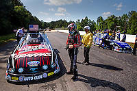 May 19, 2014; Commerce, GA, USA; NHRA funny car driver Courtney Force (left) reacts after losing to teammate Robert Hight in the final round of the Southern Nationals at Atlanta Dragway. Mandatory Credit: Mark J. Rebilas-USA TODAY Sports