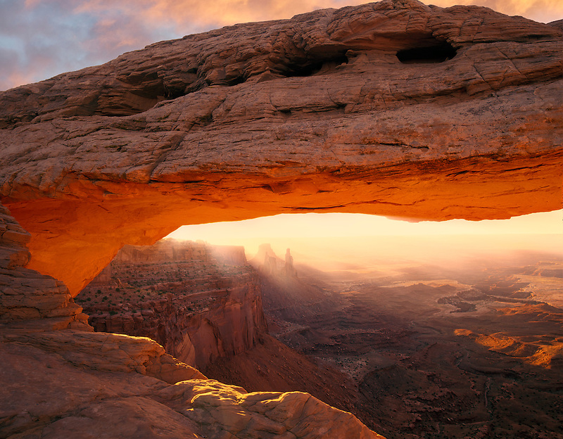 Mesa Arch with reflected morning light from canyon walls. Canyonlands National Park. Utah.