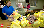 WATERBURY, CT. 21 November 2010-112210SV01--From left, Rev. Diane Rainson and Nadia Marcella of Waterbury hand out bags of food at the First Lutheran Church in Waterbury Monday. The Greater Waterbury Interfaith Ministries were handing out about 375 Thanksgiving turkeys and other food items.<br /> Steven Valenti Republican-American