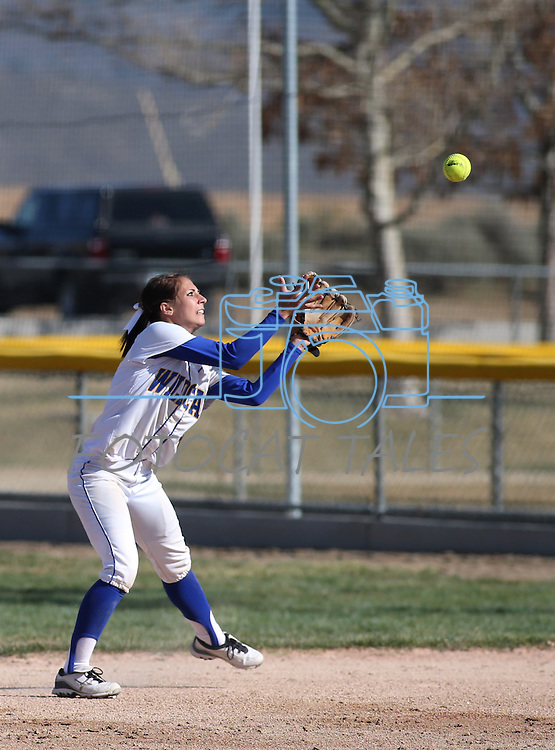 Western Nevada's Madison Gonzalez makes a play in a college softball game against College of Southern Idaho in Carson City, Nev., on Friday, March 22, 2013..Photo by Cathleen Allison