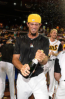 Jacksonville Suns pitcher Jheyson Manzueta (6) celebrates after game three of the Southern League Championship Series against the Chattanooga Lookouts on September 12, 2014 at Bragan Field in Jacksonville, Florida.  Jacksonville defeated Chattanooga 6-1 to sweep three games to none.  (Mike Janes/Four Seam Images)