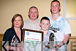 The O'Shea family from Tralee gathered around Robert as he was presented with the Merit Certificate and the Kerry Garda Special Youths Award on Friday night in the Brandon Hotel, Tralee. L-r: Pauline, Martin, Gavin and Robert O'Shea..........