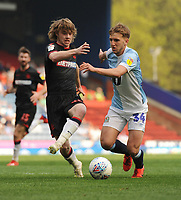 Blackburn Rovers' Daniel Butterworth under pressure from Bolton Wanderers' Luca Connell<br /> <br /> Photographer Kevin Barnes/CameraSport<br /> <br /> The EFL Sky Bet Championship - Blackburn Rovers v Bolton Wanderers - Monday 22nd April 2019 - Ewood Park - Blackburn<br /> <br /> World Copyright © 2019 CameraSport. All rights reserved. 43 Linden Ave. Countesthorpe. Leicester. England. LE8 5PG - Tel: +44 (0) 116 277 4147 - admin@camerasport.com - www.camerasport.com