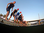 CHATTANOOGA, TN - SEPTEMBER 8:  Women triathletes prepare to enter the water during the the Women's IRONMAN 70.3 St. World Championships on September 9, 2017 in Chattanooga, Tennessee. (Photo by Donald Miralle for Ironman)