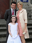 Faye Brady from Scoil Mhuire Fatima who made her First Holy Communion in St Mary's church pictured with her parents Noel and Sinead. Photo: Colin Bell/pressphotos.ie