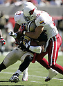 Ifeanyi Ohalete during the Cardinals v. Saints football game on October 3, 2004.Cardinals win 34-10..Dilip Vishwanat / SportPics
