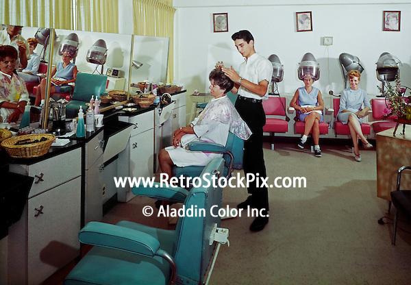 Man cutting hair at Pan American Motel hair salon. Wildwood, New Jersey motel in the 1960's.