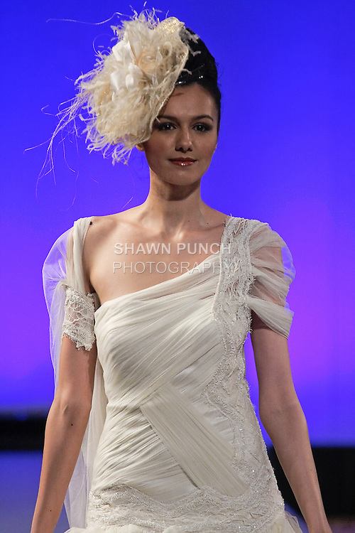 Model walks runway in a wedding dress by Isabel Zapardiez, during Couture Fashion Week New York Fall 2012.
