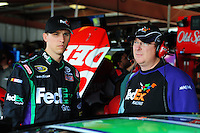 May 1, 2009; Richmond, VA, USA; NASCAR Sprint Cup Series driver Denny Hamlin (left) with crew chief Mike Ford during practice for the Russ Friedman 400 at the Richmond International Raceway. Mandatory Credit: Mark J. Rebilas-