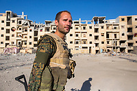 August 2017. YPG Media Centre, Raqqa, Syria.<br /> Foreign volunteer fighter 'Macer Gifford' on the front lines of Raqqa.<br /> The MFS (Syriac Military Council) are a group of Assyrian Christians who fight alongside the Syrian Democratic Forces in the fight to topple ISIS.<br /> Photographer: Rick Findler