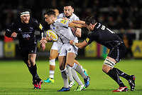 George Ford of Bath Rugby fends Calum Green of Newcastle Falcons. Aviva Premiership match, between Newcastle Falcons and Bath Rugby on January 6, 2017 at Kingston Park in Newcastle upon Tyne, England. Photo by: Patrick Khachfe / Onside Images
