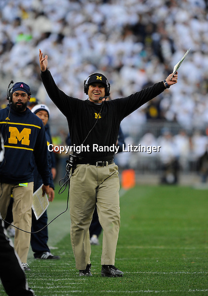 21 November 2015:  Michigan head coach Jim Harbaugh lifts his arms and celebrates after a pass interference penalty. The Michigan Wolverines defeated the Penn State Nittany Lions 28-16 at Beaver Stadium in State College, PA. (Photo by Randy Litzinger/Icon Sportswire)