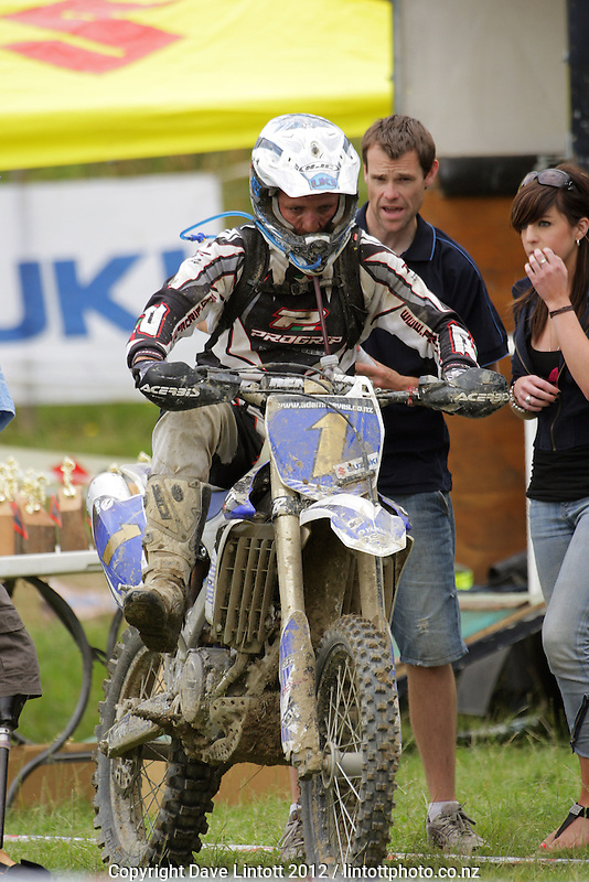 Adam Reeves makes a pitstop during the first round of the New Zealand Cross-country Motocross championships at Lewis Farm, Pahiatua, Wairarapa, New Zealand on Sunday, 19 February 2012. Photo: Dave Lintott / lintottphoto.co.nz
