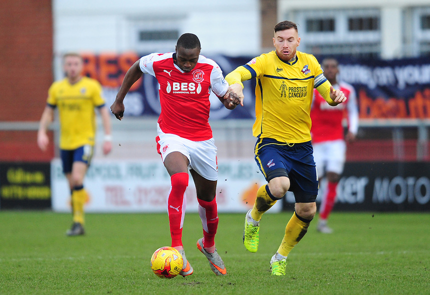 Fleetwood Town&rsquo;s Shola Ameobi vies for possession with Scunthorpe United's Jack King<br /> <br /> Photographer Chris Vaughan/CameraSport<br /> <br /> Football - The Football League Sky Bet League One - Fleetwood Town v Scunthorpe United  - Saturday 20th February 2016 - Highbury Stadium - Fleetwood    <br /> <br /> &copy; CameraSport - 43 Linden Ave. Countesthorpe. Leicester. England. LE8 5PG - Tel: +44 (0) 116 277 4147 - admin@camerasport.com - www.camerasport.com