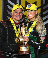 Feb 28, 2016; Chandler, AZ, USA; NHRA top fuel driver Leah Pritchett (right) celebrates with funny car driver Tim Wilkerson after winning the Carquest Nationals at Wild Horse Pass Motorsports Park. Mandatory Credit: Mark J. Rebilas-