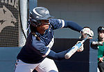 March 7, 2012:   Nevada Wolf Packs Lauren Lastrapes squares to bunt against the Sacramento State Hornets during their NCAA softball game played at Christina M. Hixson Softball Park on Wednesday in Reno, Nevada.