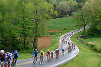 The peloton moves down a country road during Stage 5 of the Ford Tour de Georgia. Tom Danielson, of the Discovery Channel Pro Cycling Team, won the 94.5-mile (152.1-km) stage from Blairsville to the top of Brasstown Bald, the highest point in the state.<br />