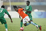 07 August 2008: Solomon Okoronkwo (NGA) (11) fouls Royston Drenthe (NED) (15).  The men's Olympic team of the Netherlands played the men's Olympic soccer team of Nigeria at Tianjin Olympic Center Stadium in Tianjin, China in a Group B round-robin match in the Men's Olympic Football competition.