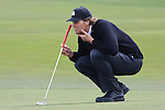 Tom Brady lining up putt at Monterey Peninsula Country Club