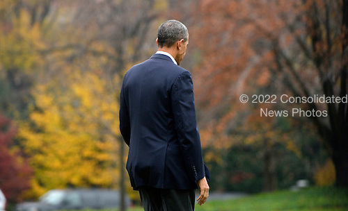 United States President Barack Obama walks across the South Lawn before departing the White House on board Marine One November 29, 2015 in Washington, DC. Nearly 150 world leaders including President Obama are expected to descend on Paris for the start of the United Nations climate change summit, which begins Monday in the French capital.<br /> Credit: Olivier Douliery / Pool via CNP